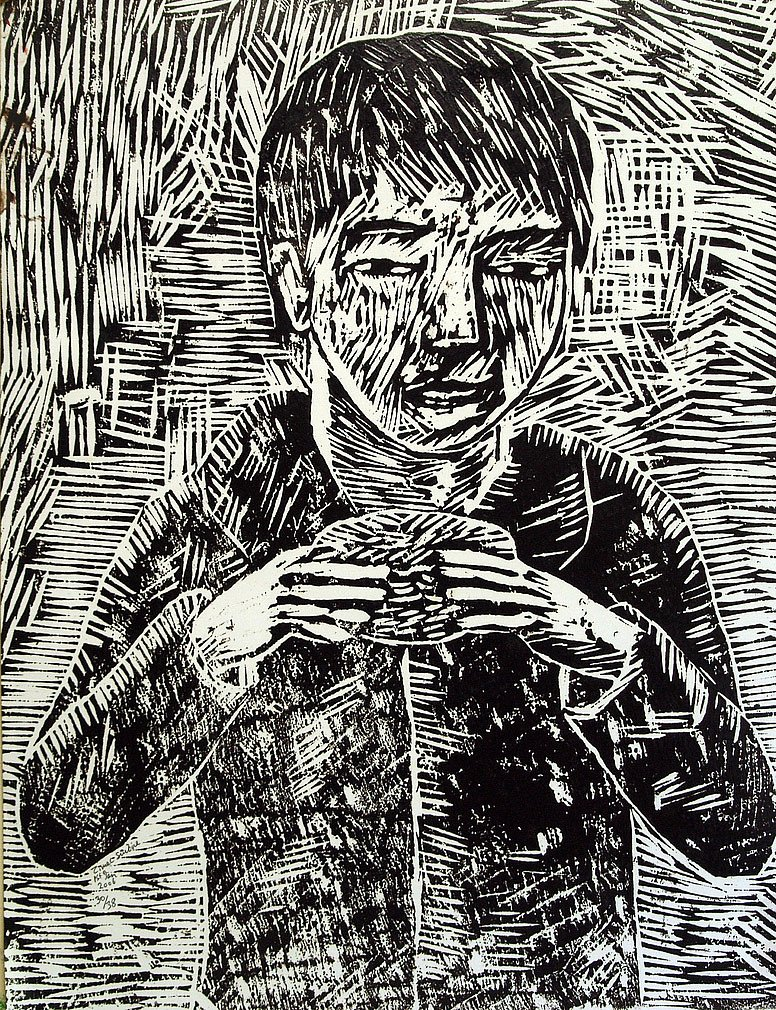 Boy with hamburger by Tadhg McSweeney